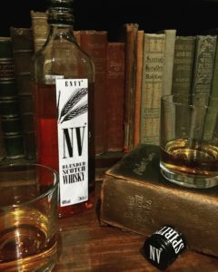 Bottle of Envy NV Whisky with 2 glasses of whisky Robert Burns book
